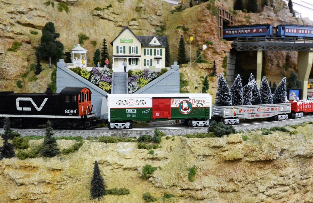 PETER R. BARBER/DAILY GAZETTE PHOTOGRAPHER A Christmas themed train rounds a corner on the tracks of the operating railroad display at Mohawk Valley Railroad Company in RotterdamThursday, December 3, 2015.