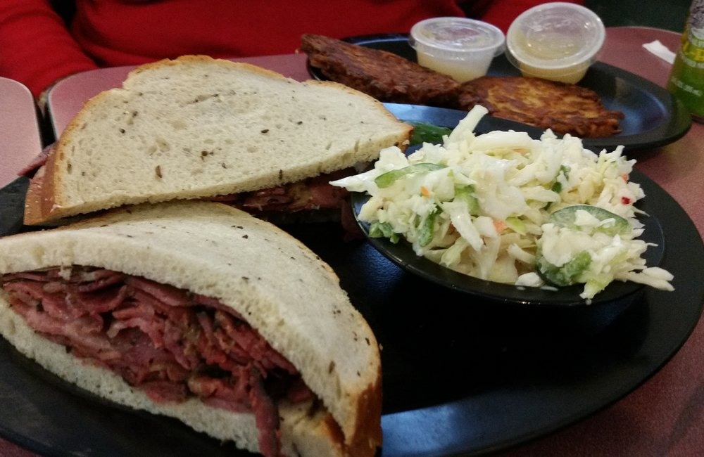 CAROLINE LEE. Gershon's hot pastrami on rye with homemade cole slaw and potato pancakes, with applesauce.