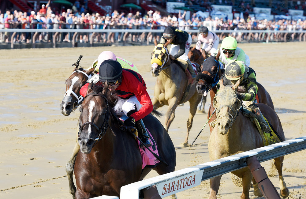 ERICA MILLER/GAZETTE PHOTOGRAPHER Luis Saez atop Weekend Hideaway, trained by Phil Serpe wins the 15th running of The John Morrissey stakes at Saratoga Race Course in Saratoga Springs, on Thursday, July 26, 2018.