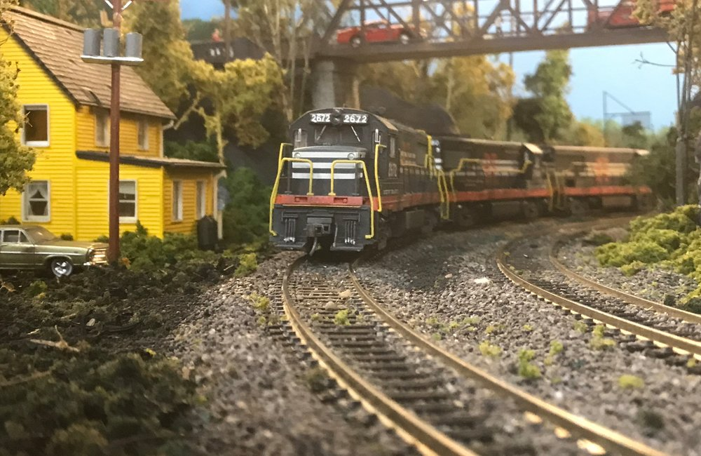 Model railroader Dave Magill's train layout includes a replica of the the Poughkeepsie-Highland Railroad Bridge over the Hudson River.