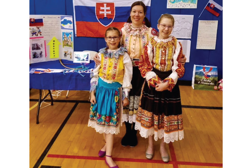 Zuzana Lundeen and her daughters, Nela, on the left, and Emma, right, wear traditional Slovakian dresses during Cultural Night at Division Street Elementary School in Saratoga Springs. The dresses were made by Zuzana's grandmothers. Photo provided by Zuzana Lundeen