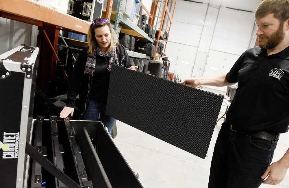ERICA MILLER/GAZETTE PHOTOGRAPHER   Roger and Christine Sharp take out one of their video walls, which was used at Rivers Casino Super Bowl party, inside their new office space in Wilton on Route 50 on Thursday, February 7, 2019.