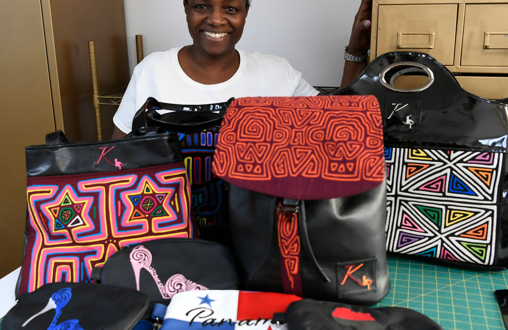 PETER R. BARBER/GAZETTE PHOTOGRAPHER Kema Maxwell owner of Kema Kreations in Albany with a variety of hand bags and clutches Thursday, February 14, 2019.