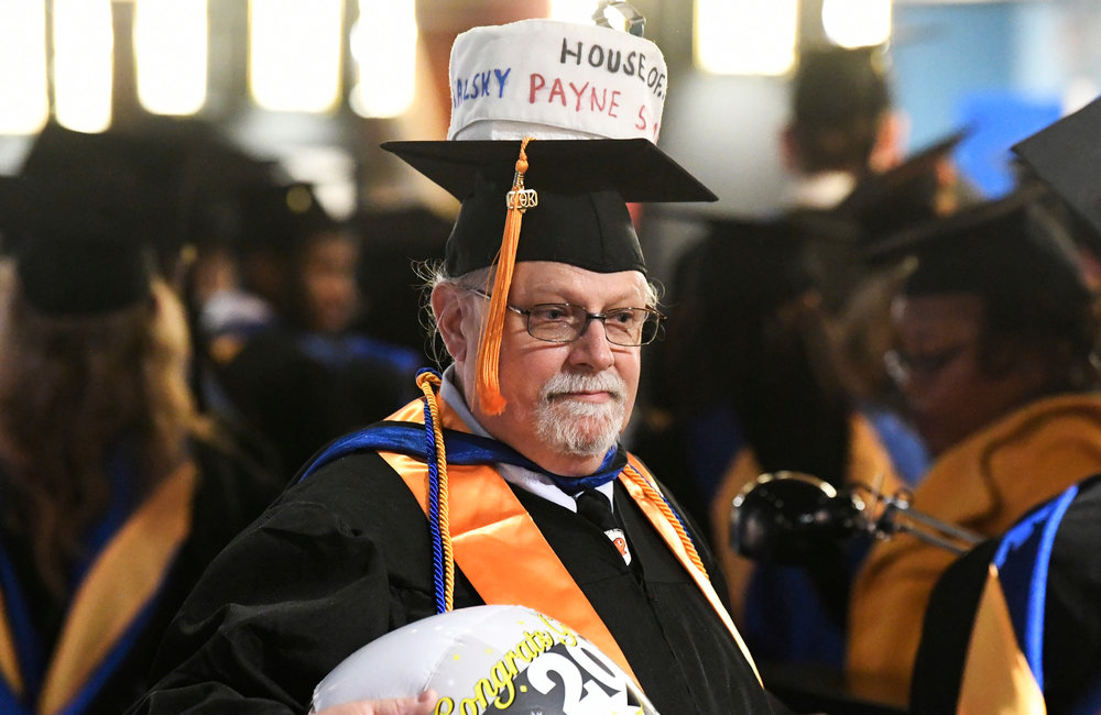 PETER R. BARBER/GAZETTE PHOTOGRAPHER SUNY Schenectady graduate Mark Burdess of Schenectady lines up with nearly 500 fellow graduates at Proctors Theatre for the 49th Commencement Thursday, May 23, 2019.