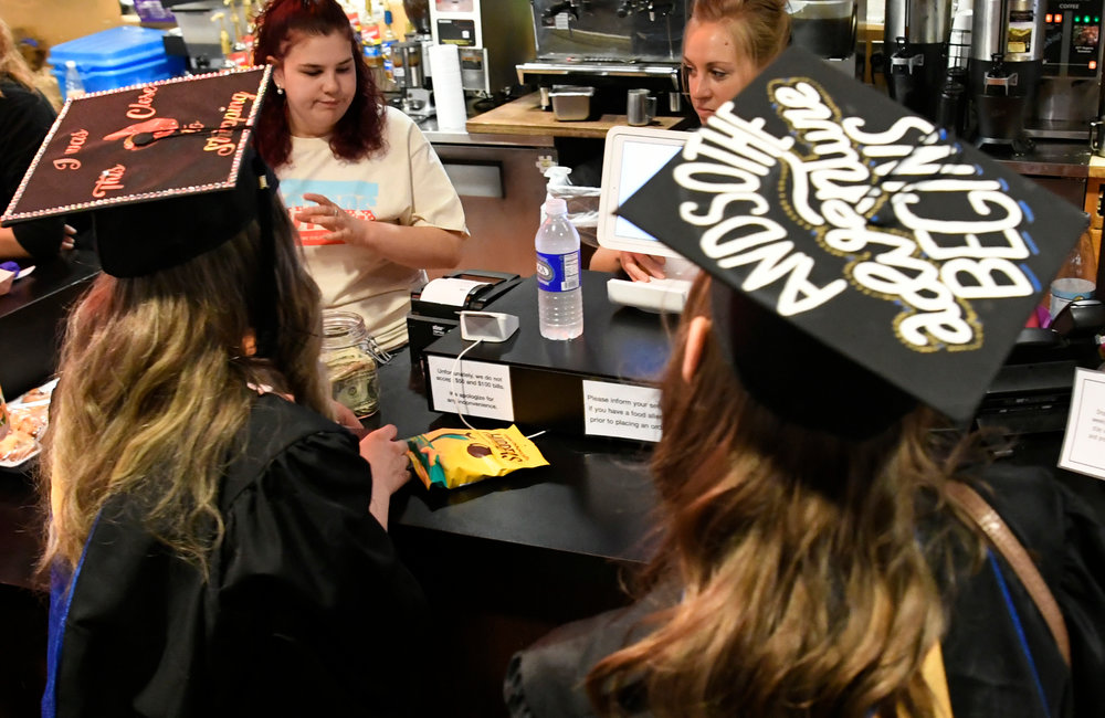 PETER R. BARBER/GAZETTE PHOTOGRAPHER SUNY Schenectady graduates Sabrina Balzan of Bethlehem, left, and Lily Reid of Clifton Park stop at the Apostrophe Cafe for a snack at Proctors Theatre for the 49th Commencement Thursday, May 23, 2019.