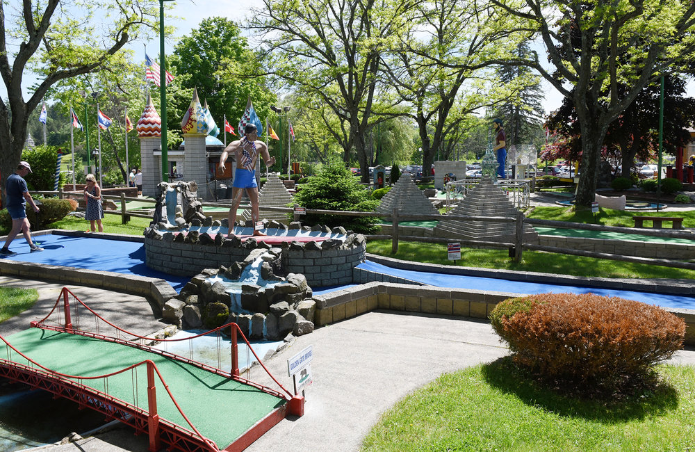 ERICA MILLER/GAZETTE PHOTOGRAPHER   Customers play a round of mini-golf at Around The World in Lake George on Sunday, June 9, 2019.