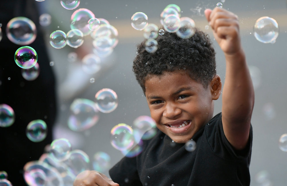 PETER R. BARBER/GAZETTE PHOTOGRAPHER Malieck Rowe, 5, of Schenectady plays in bubbles at the 2019 Summer Night on State Street Friday, July 12,  2019.