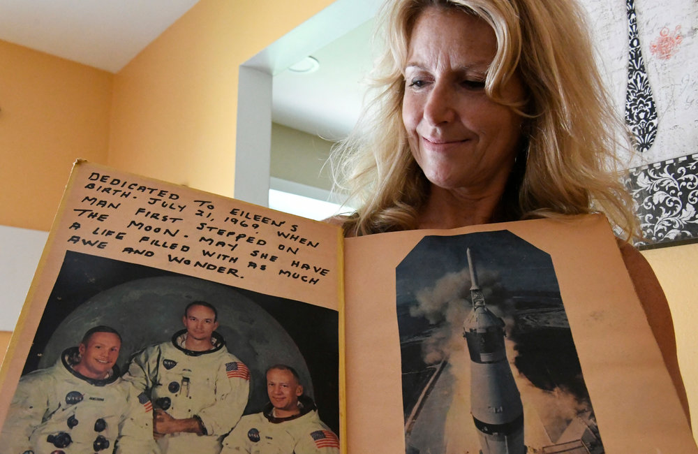 PETER R. BARBER/GAZETTE PHOTOGRAPHER Eileen Carson of Clifton Park holds a scrapbook of the Apollo 11 moon landing  Tuesday, July 16,  2019.