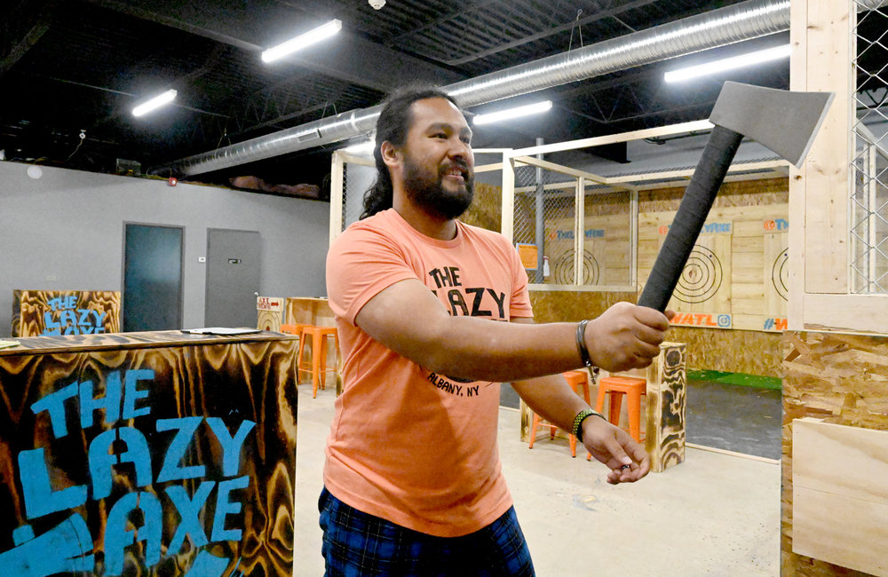 MARC SCHULTZ/GAZETTE PHOTOGRAPHER Mark Mirasol, owner of The Lazy Axe located on Central Ave. in Colonie gets prepared to toss his throwing axe.