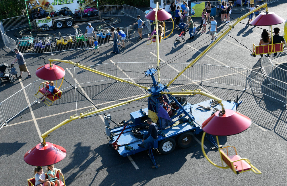 PETER R. BARBER/GAZETTE PHOTOGRAPHER Midway rides at the Our Lady Queen of Peace Festa in Rotterdam Friday, August 9, 2019.