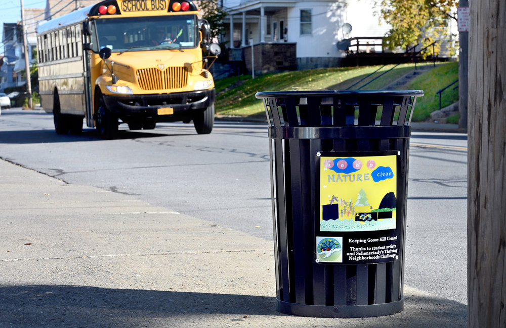 MARC SCHULTZ/GAZETTE PHOTOGRAPHER The Goose Hill neighborhood unveiled its first trash cans decorated with local students' artwork themed at keeping the community clean. Fifty trash cans are strategically placed on neighborhood streets, paying close attention to high foot traffic areas. This one is seen on Van Vranken Ave.