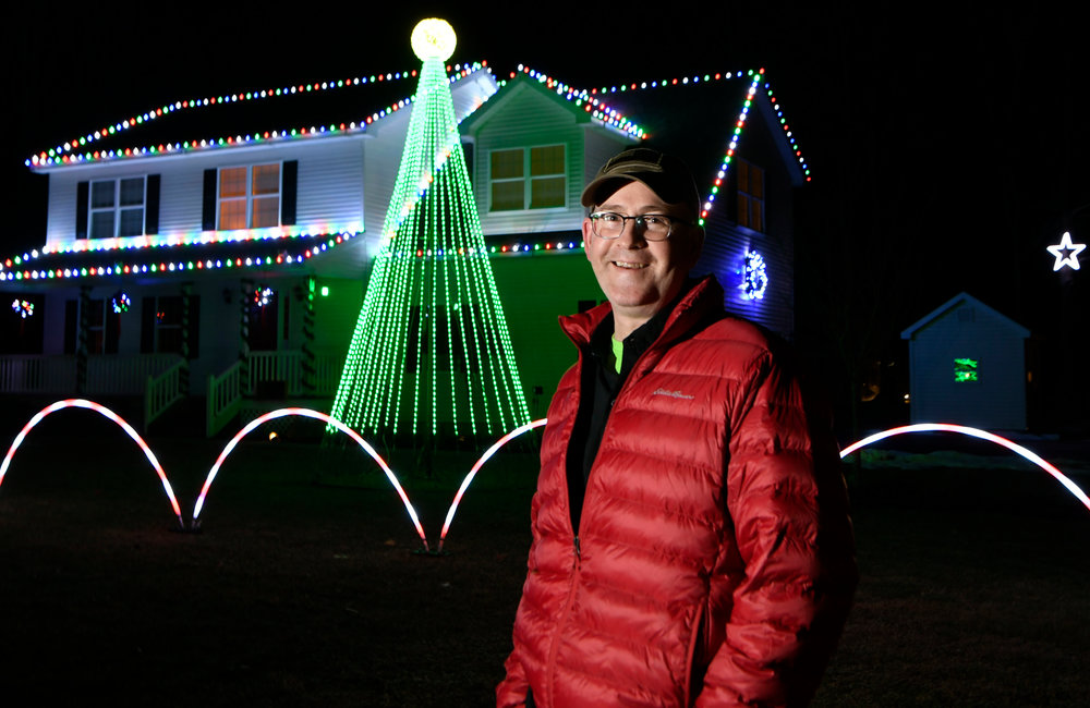 PETER R. BARBER/GAZETTE PHOTOGRAPHER Charlie Smith in front of his lit up house on Stage Road in Charlton Tuesday, November 26, 2019.