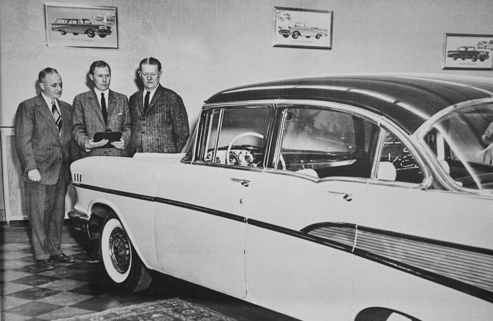 """MARC SCHULTZ/STAFF PHOTOGRAPHER Joseph """"Buzz"""" Haraden, center, with Mohawk Chevrolet salesmen on State St. in Schenectady."""