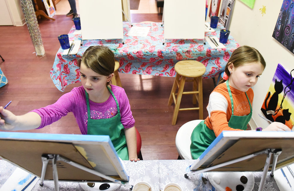 ERICA MILLER/STAFF PHOTOGRAPHER   Hannah Bentley (left) and Anna Seplowitz, both 8 of Ballston Spa, work on a piece during a class at Paint-N-Gogh studio on Milton Ave in Ballston Spa on Sunday, January 26, 2020.
