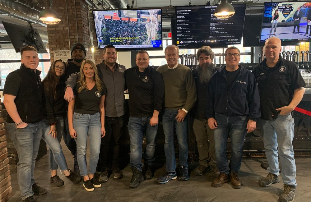 PHOTO PROVIDED Actor and craft brewer Kelsey Grammer, center, stands with the Frog Alley crew during a visit to the Schenectady brewery on Jan. 27, 2020.