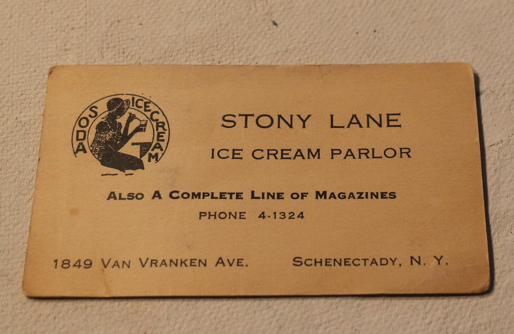 JOHN CROPLEY/BUSINESS EDITOR An original business card from the Van Vranken Avenue ice cream parlor operated many decades ago by Anthony and Margaret Pellegrino. Their grandson Donald Glennon now runs Dragonfly Pottery in the same space.
