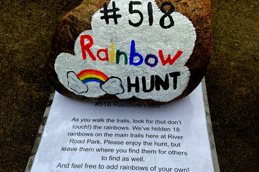"A laminated sign placed under a ""518 Rainbow Hunt"" sign tells visitors to Niskayuna's River Road Park that colored stones and rocks are hidden near the walking trails. Susan Guilmette and her daughter Anna painted the stones; visitors are adding their own contributions. Photo courtesy Susan Guilmette"