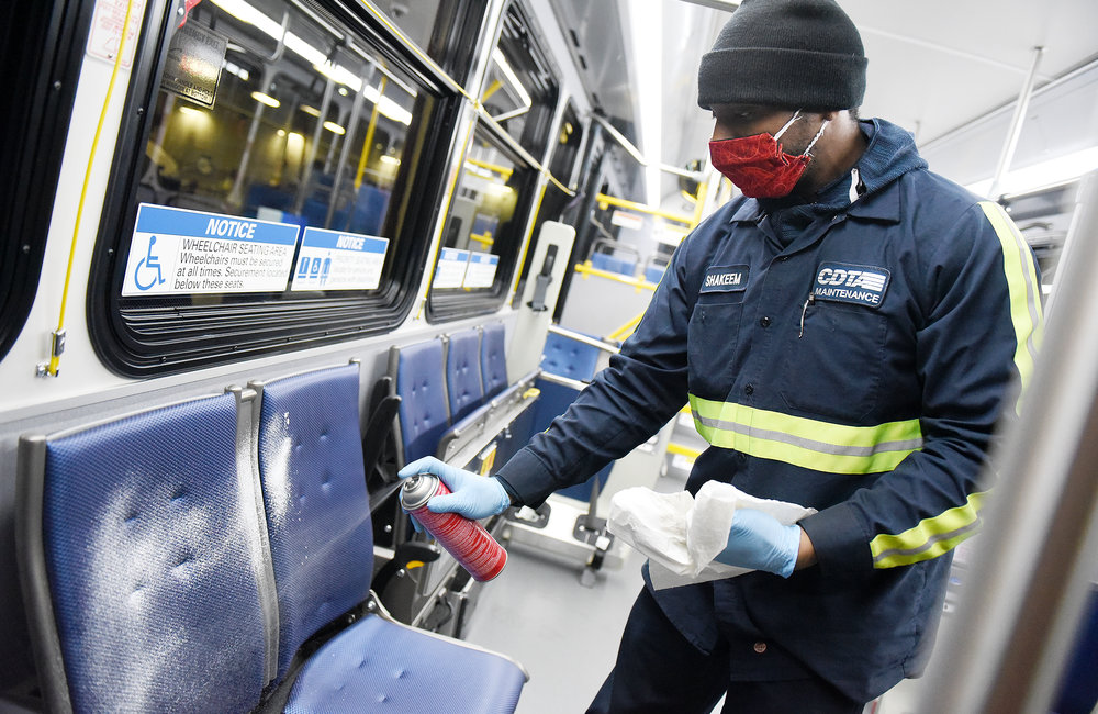 ERICA MILLER/STAFF PHOTOGRAPHER   CDTA Maintenance service technician Shakeem Plater, of Albany, deep-cleans a bus at the Albany CDRA Maintenance Headquarters during the COVID-19 pandemic in Albany on Friday, May 1, 2020.