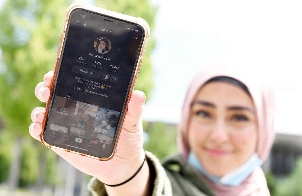 ERICA MILLER/STAFF PHOTOGRAPHER   TikTok influencer Zahra Hashimee, of Clifton Park and Shenendehowa graduate, shows her TikTok page at UAlbany campus in Albany on Friday, August 7, 2020. Hashimee has over 2.7 million followers from her videos.